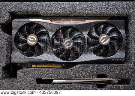Budapest, Hungary - Circa 2020: Nvidia Geforce RTX 3090 Graphics Card manufactured by EVGA unboxed on a desk. Model: EVGA Geforce RTX 3090 FTW3 Ultra, Nvidia Ampere architecture GPU released in 2020