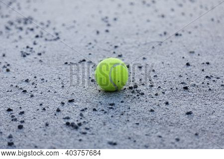 Abandoned Tennis Ball In Schoolyard At Roback