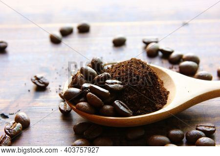 Roasted Coffee Beans Mix Ground Coffee On Wooden Spoon , Roasted Coffee Beans On Retro Wood Floor