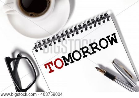 Tomorrow, Text On White Notepad Paper On White Background