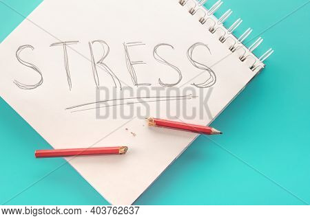 Stress Menagement Concept. Notepad With Word Stress And Broken Pencil In Case Of Panic Attack. Reduc