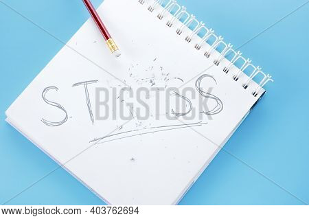 Stress Concept. Word Stress Write On Notebook. Pencil With Eraser Strokes Word Stress. Reduce, Relie