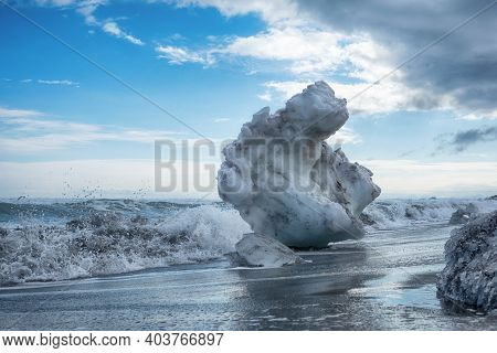 Ice Blocks Off The Coast Of The Pacific Ocean, Washed Ashore. Beautiful Winter Sunny Landscape Of Th