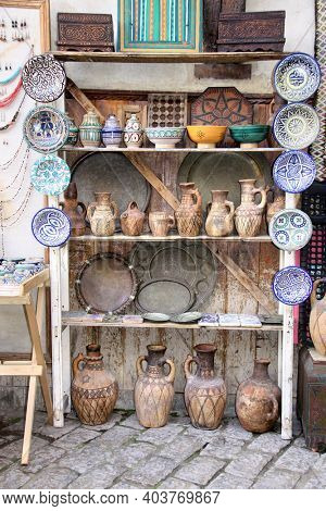 Traditional moroccan souvenirs - plates, jug and pots made of clay, souk in Essaouira, Morocco, North Africa