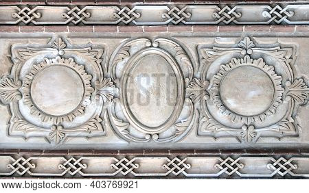 Ancient bas-relief with floral and geometrical ornament and frames on stone wall, Iran. Copy space for text