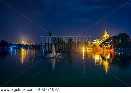 Shwedagon Pagoda With Karaweik Palace At Night, Yangon, Myanmar