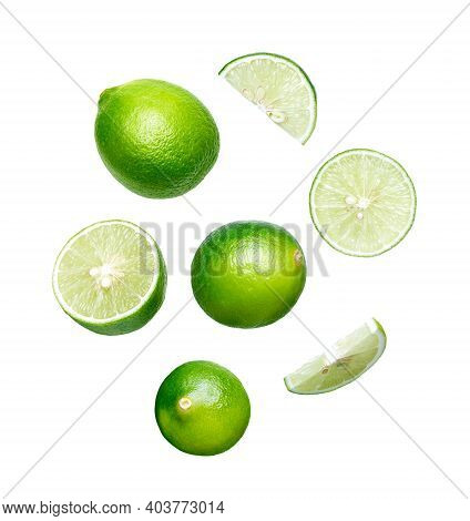 Set Of Whole, Half And Cut Slice Fresh Lime Isolated On White Background