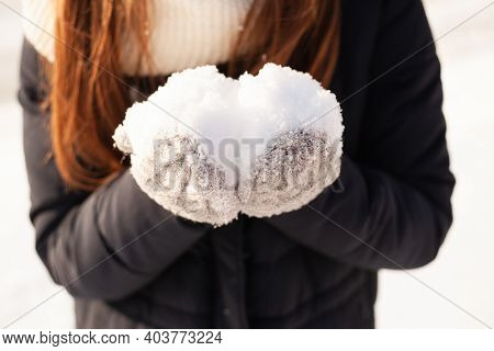 Woman Holding Snowball, Close-up Hands. Holding Natural Soft White Snow In His Hand, Outdoors. Winte