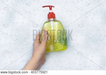 Bottles Of Detergents Float In The Foam. The Concept Of The Dangers Of Household Chemicals. Sodium L