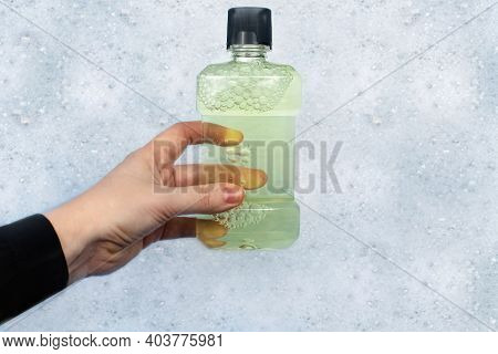 Detergent Bottles Float In The Foam. The Concept Of The Dangers Of Household Chemicals. Laureate Of