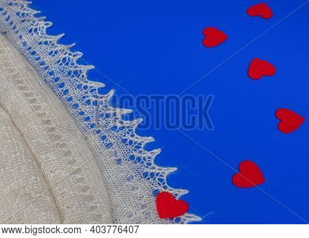 Valentine Scene With White Shawl And Felt Red Hearts On Blue Background. Love Concept. Minimal Flat