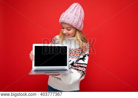 Photo Of Beautiful Charming Smiling Blonde Young Woman Holding Computer Laptop With Empty Monitor Sc
