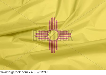 Fabric Flag Of New Mexico. Crease Of New Mexico Flag Background, The States Of America, The Red And
