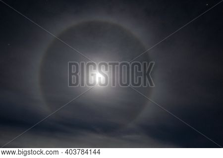 Moon Halo on night sky - glowing light around the moon