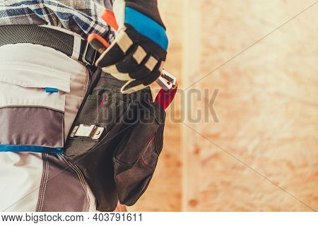 Worker Preparing For His Remodeling Job. Handyman Worker Tool Belt Close Up. Construction Industry T