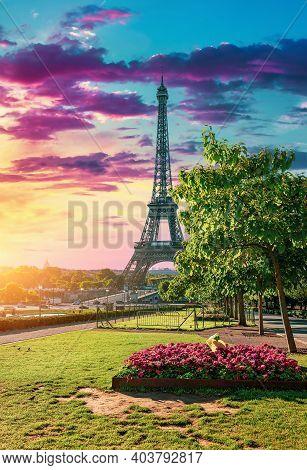 Metal Eiffel Tower And Garden In Paris, France
