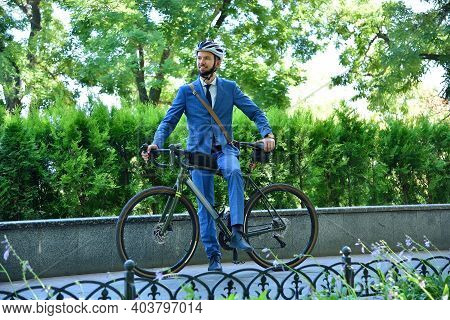 Bearded Businessman In Helmet And Suit With Bike. Business And Urban Style Concept.