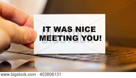 A Man Holds A Business Card With The Words It Was Nice Meeting You