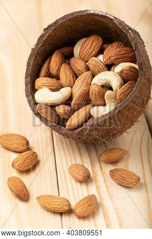 Mix Nuts On Rustic Wood Background. Cashew, Almonds Close Up. Healthy Food And Snack