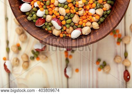 Bowl With Different Raw Legumes On Table Close Up, Top View, Copy Space. Vegan Protein Source