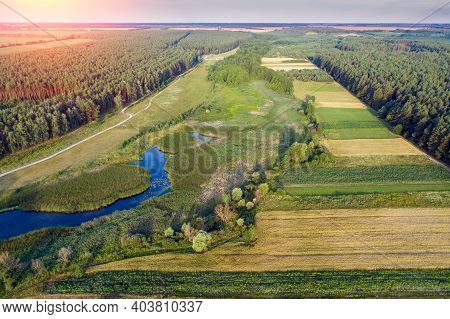 Top View Of The Rural Landscape. View Of Colorful Arable Fields In Summer