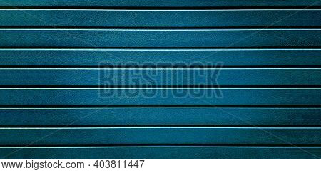 Blue Plastic Fence Striped Texture Background. By Type Of Wood Simulating The Wooden Surface Of The