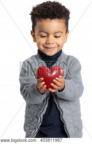Close Up Studio Portrait Of Cute Afro American Boy Holding Red Heart In Hands. Conceptual Idea Of Ki