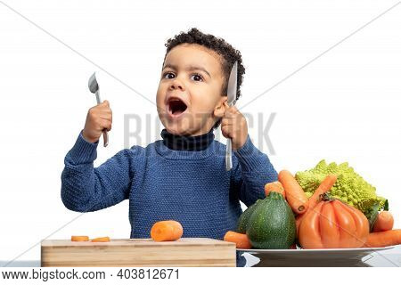 Close Up Fun Portrait Of Afro American Kid In Front Of Bowl With Vegetables.boy Holding Knife And Fo