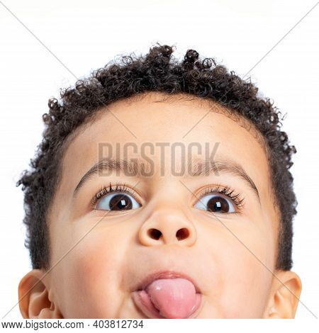 Macro Close Up Fun Portrait Of Cute Afro American Boy Pulling Tongue. Isolated On White Background.