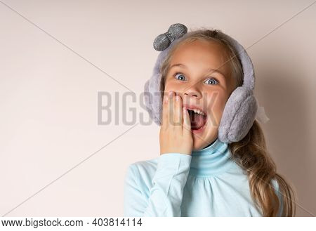 Little Cute Toothless Girl Fooling Around And Laughing With An Open Mouth Voice, In Warm Fur Headpho