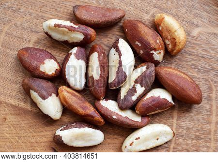 Peeled Brazil Nuts On A Wooden Background. A Source Of Beneficial Trace Elements And Fats. Bertholle