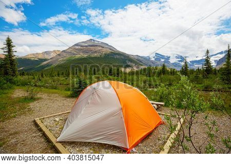 Hiking tent in the mountains in summer season