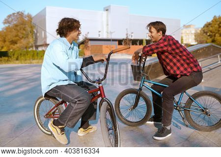 Bmx bikers on bikes, training in skatepark