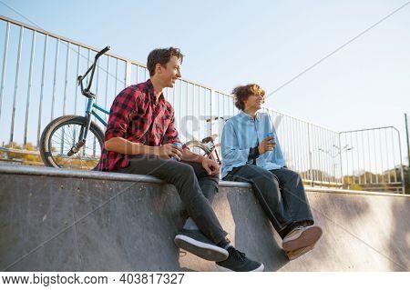 Bmx bikers leisures in skatepark after training