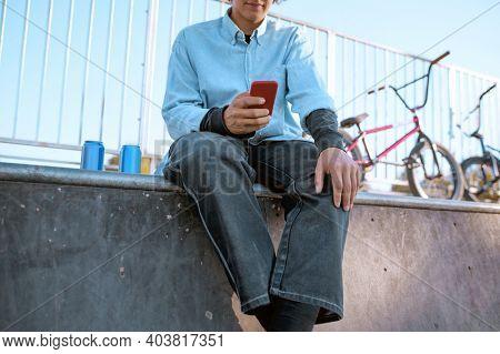 Male bmx biker leisures on ramp in skatepark