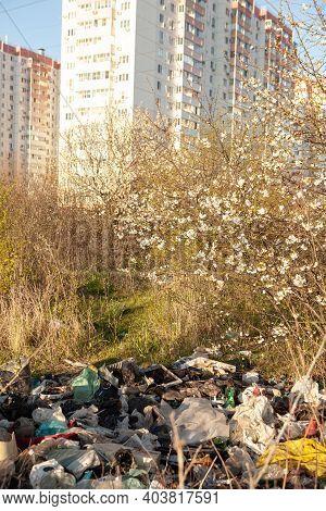 Environmental Pollution. Garbage Dump In The Field. Illegal Garbage Dump