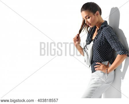 Beauty model girl posing in trendy fashionable spring clothes, wear, apparel.  Beautiful young brunette woman in trendy outfit, fashion accessories. Isolated on white background. Urban street style