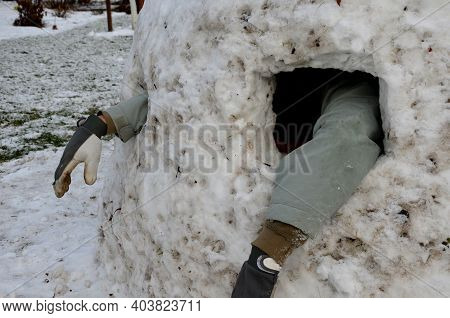 Buried Man Under An Avalanche Of Snow Looking With His Hand Where His Friend Is. Watching Hands From