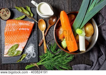 Ingredients For Lohikeitto, Classic Finnish Fish Soup  - Cream, Potato, Carrots, Leek And Dill In A