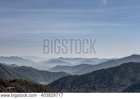 Haze Settles In The Valley Between The Ridges With Blue Sky In Great Smoky Mountains National Park