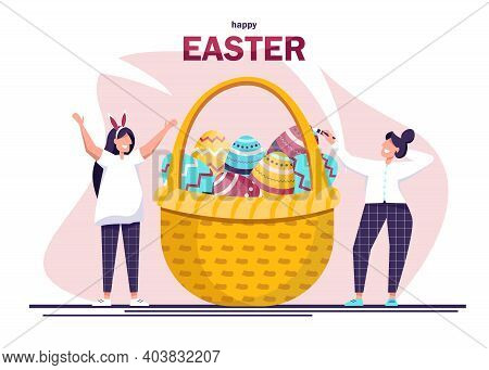 Happy People In Celebrating Easter And Painting Easter Eggs. Giant Easter Basket Of Eggs Eggs And Pe