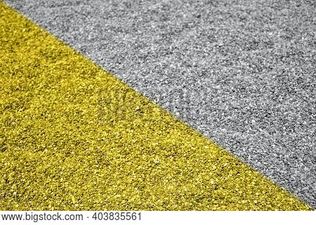 Toned In Yellow And Gray Background With Large Pebbles Or Shingle On The Beach In Natural Shades. Pe
