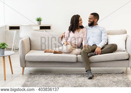 Spending Time Together. Positive African American Couple Enjoying Weekend, Sitting Relaxing On The C