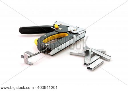 Construction Stapler And Staples Isolated On White Background