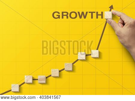 Wooden Blocks Arranged In An Increasing Graph With The Word Growth On Yellow Background. Business Gr