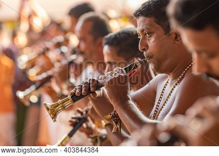 Kochi, India - February 2, 2020: Traditional south indian musicians performing during temple celebration in Cochin, India