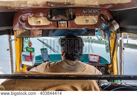 Munnar, India - November 27, 2019: View from the inside of an auto rickshaw in Kerala state, India. Tuk tuk ride in India.
