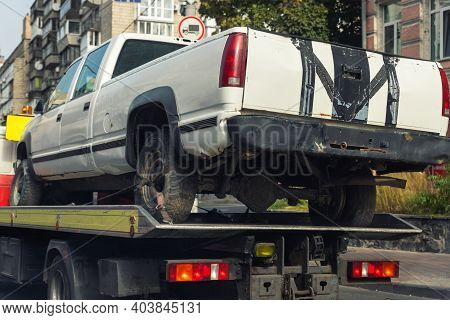 Old Wrecked Broken Pickup Vehicle Accident Transportation On Flatbed Tow Truck Machine On City Stree