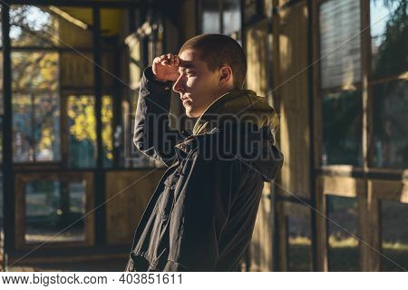 Portrait Of A Young Man In Profile With Evening Sun Looking Out
