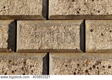 Old Gray Brick Wall. Grunge Brick Wall. Stonewall Rough Structure For Designs Backgrounds.
